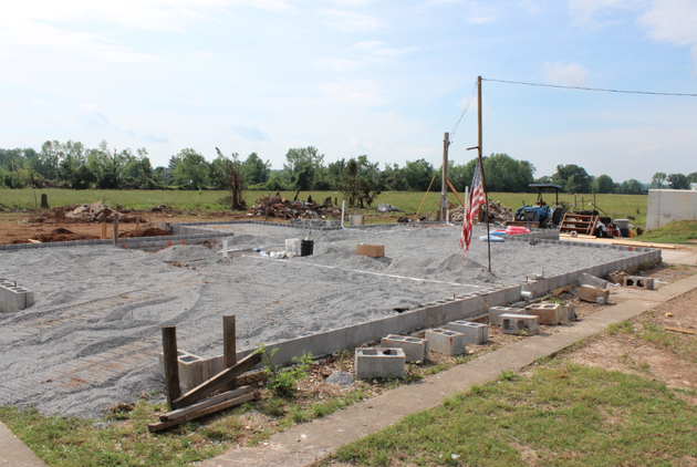 a-new-cinderblock-foundation-is-set-on-a-home-being-rebuilt-on-cemetery-road-after-a-tornado-demolished-the-previous-structure