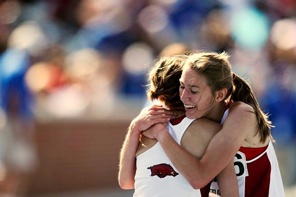 Arkansas runner Grace Heymsfield congratulates an unidentified teammate during the SEC Outdoor Championships on Saturday, May 17, 2014 in Lexington, Ky.
