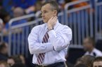 Florida head coach Billy Donovan, center, watches from the bench during a second-round game against Albany in the NCAA college basketball tournament in Orlando, Fla., Thursday, March 20, 2014.(AP Photo/Phelan M. Ebenhack)