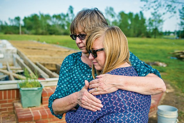 karla-stracener-hugs-her-daughter-tillie-in-front-of-the-remnants-of-their-family-home-in-center-hill-the-home-was-destroyed-by-the-areas-april-27-tornado