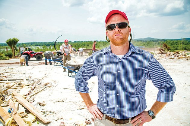 wes-craiglow-of-conway-public-information-officer-for-team-rubicon-a-nonprofit-group-of-military-veterans-and-former-first-responders-stands-at-a-homeowners-property-in-the-river-plantation-near-mayflower-craiglow-said-team-rubicon-made-up-of-military-veterans-and-former-first-responders-is-coordinating-cleanup-efforts-in-faulkner-county-and-desperately-needs-more-volunteers