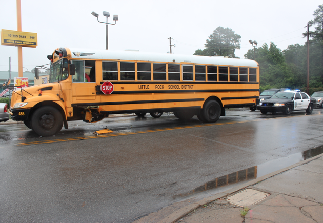 a-police-car-sits-behind-a-school-bus-after-a-hit-and-run-accident-thursday-morning-in-little-rock