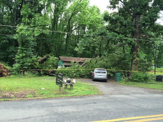 an-oak-tree-fell-thursday-morning-on-a-home-at-9417-crystal-hill-road-in-north-little-rock-temporarily-trapping-an-unknown-number-of-people-inside