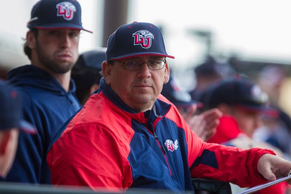 Liberty coach Jim Toman watches from the dugout during a Feb. 18, 2014 game against Old Dominion.