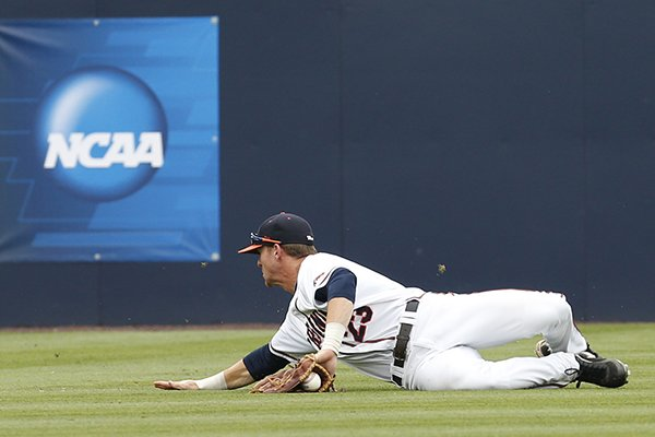 Virginia outfielder Derek Fisher (23) holds onto a fly ball during an NCAA College regional tournament baseball game against Bucknell in Charlottesville, Va., Friday, May 30, 2014. The play was ruled an out. (AP Photo/Steve Helber)