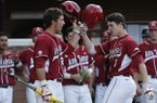 Arkansas infielder Brian Anderson (1) tips his helmet to teammate Eric Fisher (29) after he hit a solo home run in the second inning against Liberty during an NCAA college baseball tournament regional game in Charlottesville, Va., Friday, May 30, 2014. (AP Photo/Steve Helber)