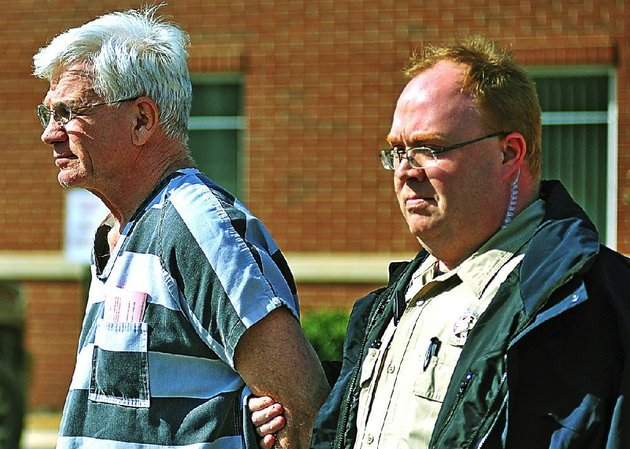 dr-paul-becton-left-an-obstetrician-gynocologist-of-paragould-is-escorted-by-a-greene-county-sheriffs-deputy-on-thursday-april-17-2014-after-a-probable-cause-hearing-at-the-greene-county-courthouse-in-paragould-becton-is-charged-with-taking-photographs-of-a-nude-female-patient-and-was-ordered-held-in-lieu-of-500000-bond