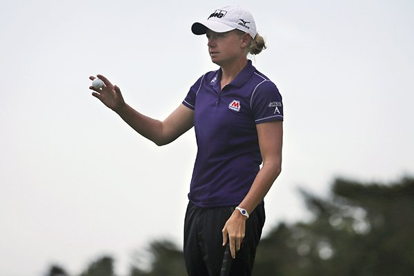 Stacy Lewis shows her ball on the 18th hole during the second round of the ShopRite LPGA Classic golf tournament in Galloway Township, N.J., Saturday, May 31, 2014. (AP Photo/Mel Evans)