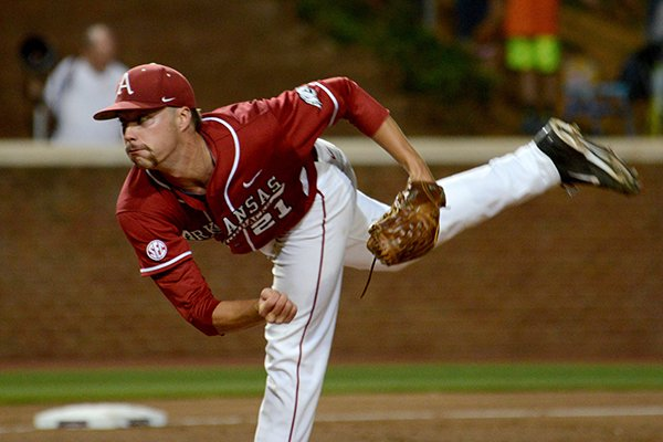 Arkansas' Trey Killian pitches during the third inning of an NCAA college baseball regional tournament game against Virginia in Charlottesville, Va., Saturday, May 31, 2014. (AP Photo/Pat Jarrett)