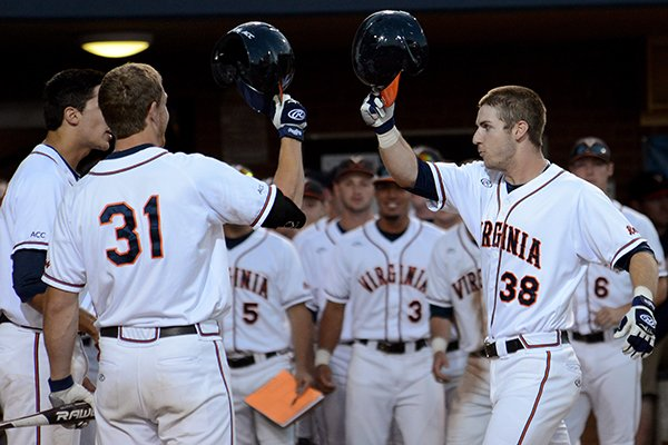 Teammates congratulate Virginia's Mike Papi (38) as he crosses home plate after hitting a two-run home run during the first inning of an NCAA college baseball regional tournament game against Arkansas in Charlottesville, Va., Saturday, May 31, 2014. (AP Photo/Pat Jarrett)