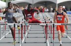 Arkansas hurdler Omar McLeod clears the final hurdle in front of David Kendziera from Illinois and James Douglas from UC Irvine during the men's 110 meter hurdles Friday at the 2014 NCAA Track & Field West Preliminaries at John McDonnell Field in Fayetteville.