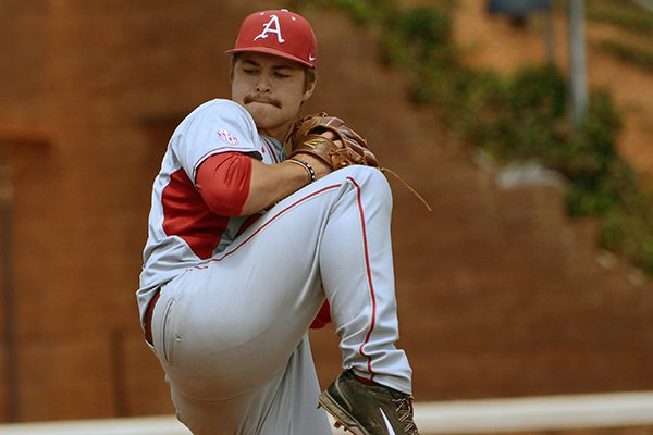Arkansas' Jalen Beeks pitches during the first inning of an NCAA college baseball regional tournament game against Bucknell in Charlottesville, Va., Sunday, June 1, 2014. (AP Photo/Pat Jarrett)