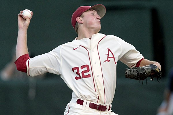 Arkansas pitcher Zach Jackson (32) throws in the first inning of an NCAA college baseball regional tournament game against Virginia, Sunday, June 1, 2014, in Charlottesville, Va. (AP Photo/Andrew Shurtleff)
