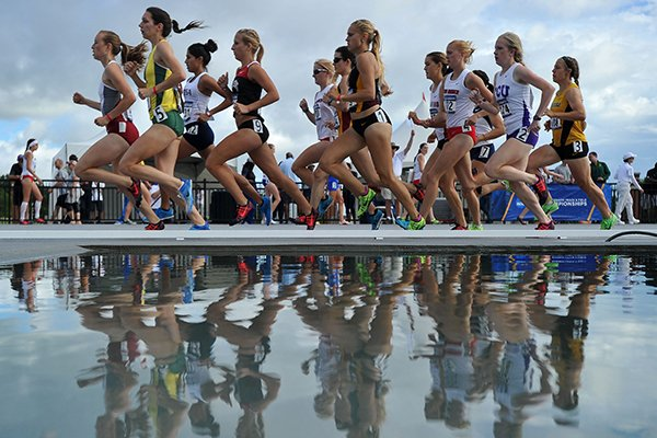 A pack of runners round the first turn in the women's 1500 meter run Thursday during the NCAA Division 1 Track & Field West Preliminary track meet at John McDonnell Field in Fayetteville.