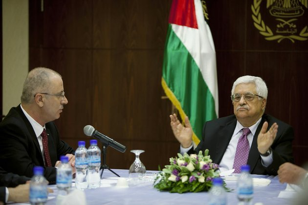 palestinian-president-mahmoud-abbas-right-talks-with-palestinian-prime-minister-rami-hamdallah-in-the-west-bank-city-of-ramallah-on-monday-june-2-2014