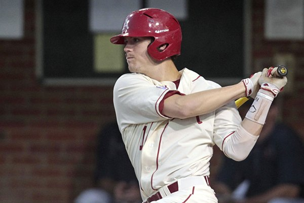 Arkansas infielder Brian Anderson (1) hits a single during an NCAA college baseball regional tournament game against Virginia, Sunday, June 1, 2014, in Charlottesville, Va. (AP Photo/Andrew Shurtleff)