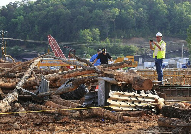 investigators-examine-a-fatal-accident-scene-in-clinton-where-officials-say-a-log-truck-lost-control-and-flipped-monday-sending-logs-flying-into-construction-workers-on-a-bridge-at-us-65-and-arkansas-16