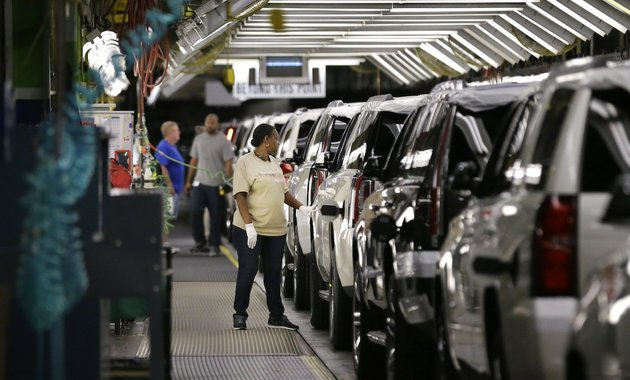 in-this-may-13-2014-file-photo-an-auto-worker-inspects-finished-suvs-coming-off-the-assembly-line-at-the-general-motors-auto-plant-in-arlington-texas