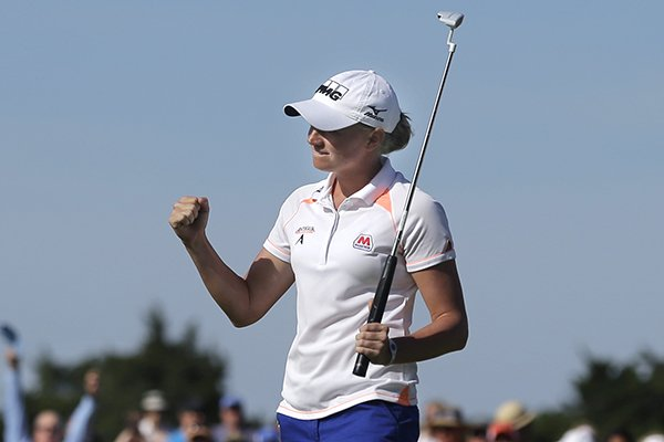 Stacy Lewis celebrates her win after a putt on the 18th hole of the final round at the ShopRite LPGA Classic golf tournament in Galloway Township, N.J., Sunday, June 1, 2014. Lewis shot 16-under-par, 197 to win the tournament. (AP Photo/Mel Evans)