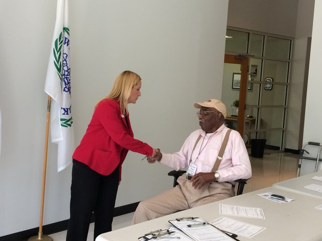 republican-attorney-general-candidate-leslie-rutledge-shakes-hands-with-a-poll-worker-at-the-pulaski-county-regional-building-on-tuesday-after-casting-her-ballot-for-arkansas-june-10-primary-runoff-early-voting-began-tuesday