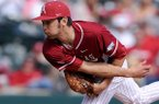 Chris Oliver pitches for Arkansas during the game against Eastern Illinois at Baum Stadium in Fayetteville on Saturday Feb. 22, 2014.
