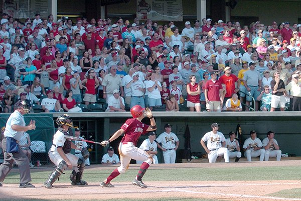 Arkansas junior Brady Toops hits a two-out grand-slam home run in the ninth inning of a Sunday, June 6, 2004 game against Wichita State at Baum Stadium in Fayetteville.