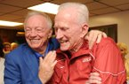 Jerry Jones, owner of the Dallas Cowboys and former Arkansas athlete, left, speaks alongside Frank Broyles, former coach and athletics director at the University of Arkansas, Friday, June 6, 2014, during the Frank and Barbara Broyles Foundation Caregivers United inaugural benefit golf scramble at Paradise Valley Golf andÊAthletic Club in Fayetteville.