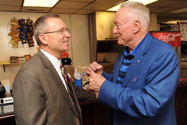 Jerry Jones, owner of the Dallas Cowboys and former Arkansas athlete, right, speaks with Jeff Long, athletics director at the University of Arkansas, Friday, June 6, 2014, during the Frank and Barbara Broyles Foundation Caregivers United inaugural benefit golf scramble at Paradise Valley Golf andÊAthletic Club in Fayetteville.