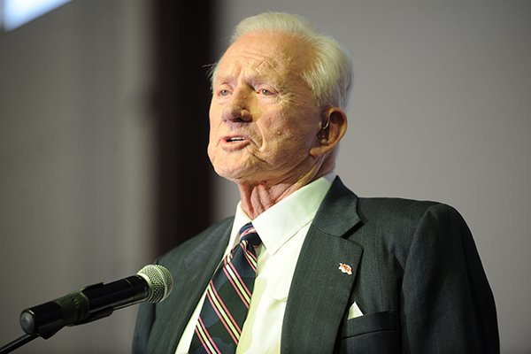 Frank Broyles, former University of Arkansas football coach and athletics director, speaks Tuesday, Nov. 26, 2013, during the Fayetteville Chamber of Commerce's annual meeting at the Bulldog Activities and Recreation Center on the Fayetteville High School campus.
