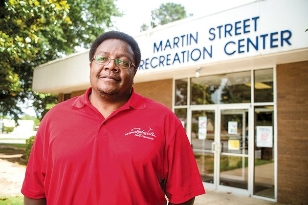 glen-lane-of-jacksonville-is-the-coordinator-for-our-club-an-after-school-program-with-a-twist-and-is-the-manager-of-the-youth-center-in-jacksonville-our-club-has-three-main-components-academics-fitness-and-community-service-lane-has-worked-for-the-jacksonville-parks-and-recreation-department-since-march-1998