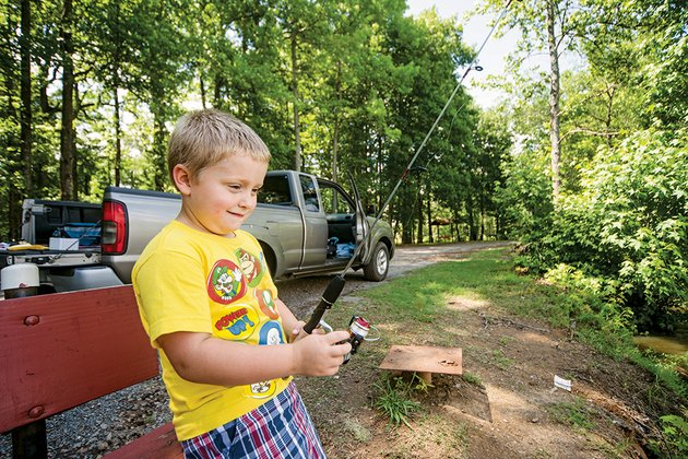 gabriel-adams-5-fishes-at-dupree-park-lake-in-jacksonville-the-lake-will-be-the-site-of-the-17th-annual-youth-fishing-derby-on-june-21-co-sponsored-by-the-arkansas-game-and-fish-commission-and-the-jacksonville-parks-and-recreation-department