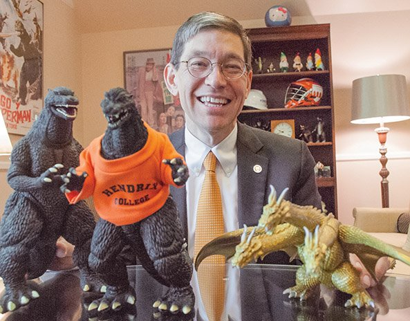 hendrix-college-president-bill-tsutsui-shows-two-of-his-many-godzilla-figures-one-of-which-is-wearing-a-hendrix-college-t-shirt-and-ghidorah-a-three-headed-monster-from-the-godzilla-movies-tsutsui-the-author-of-a-book-on-godzilla-has-his-collection-of-godzilla-paraphernalia-in-his-office-he-said-one-of-the-most-unusual-is-godzilla-with-a-clock-in-his-stomach-and-the-one-he-treasures-the-most-is-a-tin-wind-up-toy-godzilla