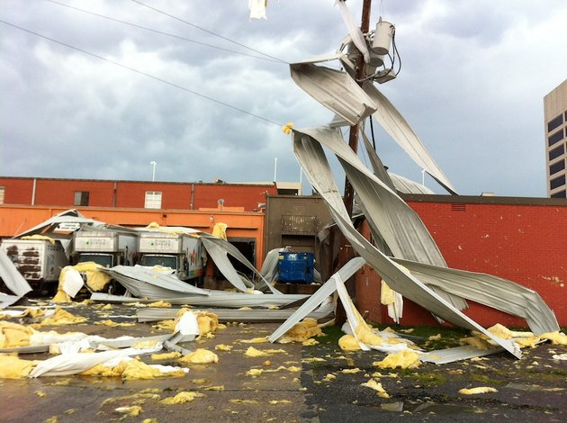 debris-is-strewn-around-a-building-and-power-pole-on-8th-street-between-gaines-and-state-streets-in-little-rock-after-powerful-thunderstorms-tore-through-central-arkansas-on-friday-june-6-2014