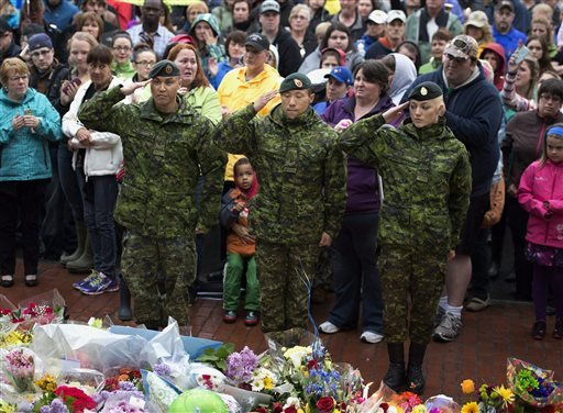 three-soldiers-participate-in-a-candle-light-vigil-in-moncton-new-brunswick-friday-june-6-2014-to-pay-respect-to-the-three-royal-canadian-mounted-police-officers-who-were-killed-and-the-two-injured-in-a-shooting-spree-on-wednesday-justin-bourque-24-is-facing-three-charges-of-first-degree-murder-and-two-charges-of-attempted-murder