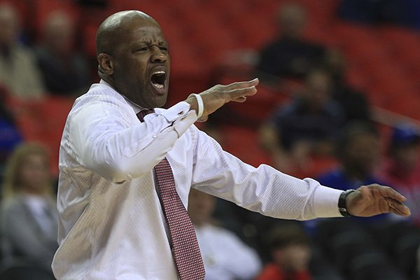 Arkansas coach Mike Anderson yells instructions to his players Wednesday, March 13, 2014 during their SEC Tournament game against South Carolina at the Georgia Dome in Atlanta.