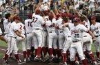 Stanford player's celebrate a one out, bottom of the ninth home run by Wayne Taylor to beat Vanderbilt 5-4 in an NCAA college baseball tournament super regional baseball game Saturday, June 7, 2014, in Nashville, Tenn. (AP Photo/Wade Payne)