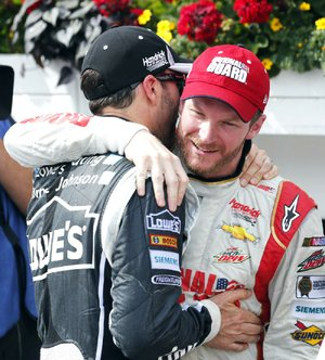 Dale Earnhardt Jr. (right) is congratulated by Jimmie Johnson after Sunday's NASCAR Sprint Cup Pocono 400 in Long Pond, Pa. Johnson entered Sunday's race with two consecutive victories, but finished sixth at Pocono. Earnhardt earned his second victory of the season.