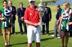 Arkansas golfer Nicolas Echavarria poses with a trophy after winning an amateur championship Sunday, June 8, 2014.