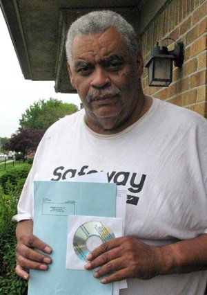 In this May 27, 2014 photo retired Detroit bus driver Art Vardiman holds a computer disk he received in the mail that holds hundreds of pages of documents, a six-page blue ballot about cuts to his pension and a white one on  health insurance in Detroit. Retirees with pensions at risk have until July 11 to vote on Detroits exit plan from bankruptcy.  General retirees like Vardiman would see a 4.5 percent cut in their pension and elimination of annual inflation payments. Police and fire retirees fare better.