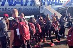 Arkansas athletes step off a plane after arriving in Eugene, Ore., on Sunday. The Razorbacks took a chartered jet along with SEC rivals Florida and LSU.