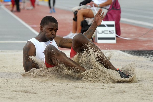 Arkansas long jumper Raymond Higgs competes at the 2014 NCAA Track and Field West Preliminary at John McDonnell Field in Fayetteville.