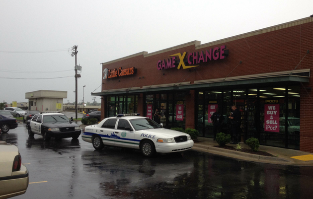 little-rock-police-respond-to-a-reported-robbery-at-game-x-change-3412-s-university-ave-in-little-rock-on-monday-june-9-2014