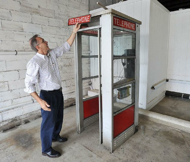 david-parks-president-of-the-prairie-grove-telephone-co-shows-the-damage-to-the-telephone-booth-that-was-located-in-front-of-the-colonial-motel-on-us-62-in-prairie-grove-for-four-decadesthe-booth-was-hit-saturday-by-a-chevy-tahoe