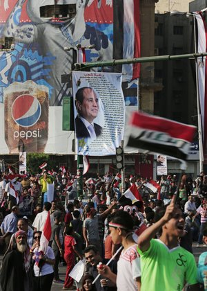 Supporters of Egyptian President Abdel-Fattah el-Sissi celebrate his inauguration Sunday in Cairo's Tahrir Square. Egyptian police on Monday arrested seven men for sexually assaulting a 19-yearold student during the rally.