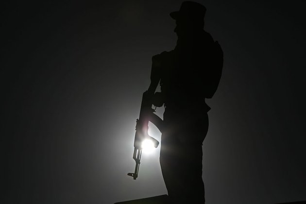 an-afghan-police-officer-stands-guard-during-a-campaign-rally-in-the-paghman-district-of-kabul-afghanistan-monday-june-9-2014-the-second-round-of-afghanistans-presidential-election-will-take-place-on-june-14-2014