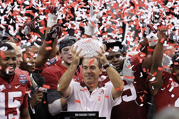 In this Jan. 9, 2012 file photo, Alabama head football coach Nick Saban celebrates with his team after the BCS National Championship college football game against LSU in New Orleans. (AP Photo/Gerald Herbert, File)