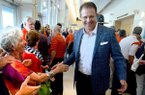 Auburn football coach Gus Malzahn is welcomed by a crowd of Auburn fans on Tuesday, May 20, 2014, for the Emerald Coast Auburn Club's annual dinner at the Emerald Coast Convention Center on Okaloosa Island in Fort Walton Beach, Fla. (AP Photo/Northwest Florida Daily News, Nick Tomecek)