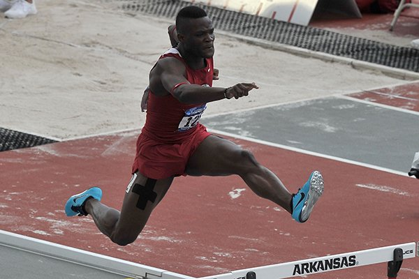 Arkansas hurdler Omar McLeod competes in the 400 meter hurdles Thursday, May 29, 2014 during the NCAA Track and Field West Preliminary meet at John McDonnell Field in Fayetteville.