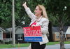 Attorney general candidate Leslie Rutledge waves to passing motorists while campaigning Tuesday morning in Little Rock.