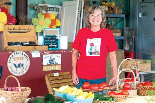cheryl-anderson-owner-and-operator-of-garden-girl-farm-fresh-produce-and-more-is-shown-with-a-variety-of-produce-at-her-stand-off-batesville-boulevard-anderson-is-one-of-the-vendors-participating-in-the-main-street-farmers-market-in-batesville-in-its-inaugural-season